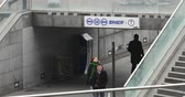 gare : PARIS, FRANCE - CIRCA 2015: People walking under the logo of SNCF company near the entrance of Gare de La Defense