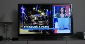 barack obama : PARIS, FRANCE - NOV 13 2013: French Television reporting live as rescuers working on the scene of the attack. At least 40 people were killed across Paris, with explosions outside the national stadium
