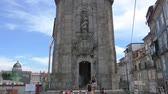 são nicolau : PORTO, Portugal - CIRCA 2016: Clerigos Church or greja dos Clerigos with its magnificent Clerigos tower and tourists admiring it on a sunny warm day Vídeos