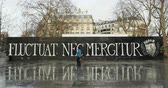 charlie hebdo : PARIS, FRANCE - CIRCA 2016: Timelapse with people in front of the Fluctuat Nec Mergitur Tossed but not sunk motto of Paris in Place de la Republique Republic square drawn in support of the victims after terrorist attack on November 13 2015 in Paris, Fra Stock Footage