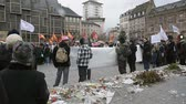 politics : STRASBOURG, FRANCE - JAN 30, 2016: Protesters gathered at Kleber Square Place Kleber during a demonstration, protesting governments plan of the extension of the state of emergency for another three months - Justice and Freedom placard