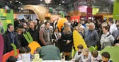przetwory : PARIS, FRANCE - FEB 2016: Parents admiring their kids being being food-chefs at the Bonduelle stand - Agricultural Show - Salon International de Agriculture. Bonduelle is a conglomerate with produce diverse fruits and vegetables products Wideo