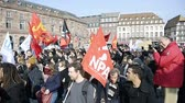 valls macrom : STRASBOURG, FRANCE - 9 MAR 2016: Thousands of people demonstrate in Place Kleber as part of nationwide day of protest against proposed labor reforms by Socialist Government