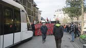 valls macrom : STRASBOURG, FRANCE - 9 MAR 2016: Blocked tramway as thousands of people demonstrate as part of nationwide day of protest against proposed labor reforms by Socialist Government Stock Footage