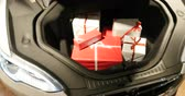 tesla motors : COPENHAGEN, DENMARK - CIRCA 2016: New Tesla Model 3 car  in showroom central Copenhagen with the trunk filled with gift boxes. Tesla is an American company that designs, manufactures, and sells electric cars Stock Footage
