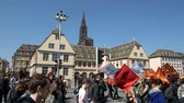 valls macrom : STRASBOURG, FRANCE - APR 20, 2016: People protesting in center of Strasbourg as part of nationwide day of protest against proposed labor reforms by Socialist Government