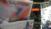 polling place : STRASBOURG, FRANCE - JUN 24, 2016: Man buying Daily Telegraph with headline titles at press kiosk about the Brexit referendum in United Kingdom which has decided the country wishes to quit the European Union