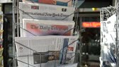 polling place : STRASBOURG, FRANCE - JUN 24, 2016: International New York Times, Financial Times, The Daily Telegraph and other major newspapers headline titles at press kiosk about the Brexit referendum in United Kingdom which has decided the country wishes to quit the  Stock Footage