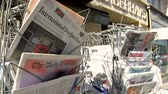 politics : STRASBOURG, FRANCE - JUN 24, 2016: International New York Times, Financial Times, The Daily Telegraph and other major newspapers headline titles at press kiosk about the Brexit referendum in United Kingdom which has decided the country wishes to quit the  Stock Footage