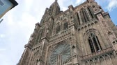 petite france : STRASBOURG, FRANCE - CIRCA 2016:  Caucasian couple visiting Strasbourg Cathedral or the Cathedral of Our Lady of Strasbourg, Cathedrale Notre-Dame de Strasbourg