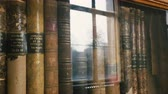 physics : Panning over old vintage books Annales de Chimie et Physique cover in old dusty library in university - books from 1897