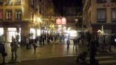 weihnachten : STRASBOURG, FRANCE - DECEMBER 2016: Slow motion pedestrian on street  Rue Hallebardes in the heart of the Carre d'Or (golden triangle) commercial district twinkle with enormous Baccarat crystal chandeliers that hang above pedestrians at Christmas Stock Footage