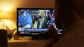 donald trump : PARIS, FRANCE - NOV 9, 2016: Happy man gestures while watching on French TV financial market reaction after USA election results  as Donald Trump is the 45th President of United States of America