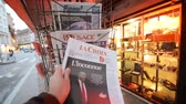 donald trump : PARIS, FRANCE - NOV 10, 2016: Man buying LA Croix newspaper with shocking headline title at press kiosk about the US President Elections - Donald Trump is the 45th President of United States of America