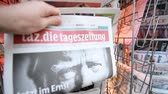 donald trump : PARIS, FRANCE - NOV 10, 2016: Man buying German newspaper Tag Die Tageszeitung with shocking headline title at press kiosk about the US President Elections - Donald Trump is the 45th President of United States of America Stock Footage