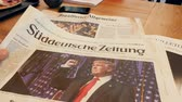 manchete : FRANKFURT, GERMANY - NOV 10, 2016: Man reading in German Café about the  Suddeutsche Zeitung newspapperwith Donald Trump elected as President as the 45th President of United States of America Vídeos