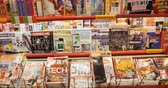article : PARIS, FRANCE - CIRCA 2016: Interior of press kiosk with covers of entertainment, computer games, console games and other leisure activities magazines covers Stock Footage