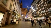 admirado : STRASBOURG, FRANCE - CIRCA 2016: Christmas Market atmosphere with  Notre-Dame Cathedral admired by tourists on Rue Merciere Stock Footage