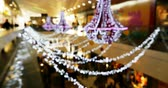 swarovski : Luxury shopping mall business convention center with defocused Bokeh of expensive chandeliers and silhouettes of people walking on corridors Stock Footage