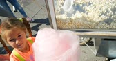 tatarak : PAPHOS, CYPRUS - CIRCA 2014: Cotton candy in hands of happy girl at fair carnival party during Ochi day Wideo