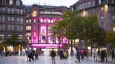 petite france : STRASBOURG, FRANCE - CIRCA 2017: Majestic Galleries Lafayette building in Place du General Kleber at dusk with beautiful architectural illuminations in central Strasbourg at dusk Stock Footage