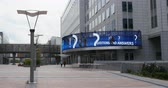 belga : BRUSSELS, BELGIUM - CIRCA 2015: Silhouettes walking European Parliament area near the The Parlamentarium giant information display - the visitors center of the European Parliament and is located in the Parliaments Espace Leopold complex in Brussels,