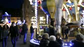 petite france : STRASBOURG, FRANCE - CIRCA 2017: Strasbourg Christmas Market atmosphere with pan from the Notre-Dame Cathedral to the funny old vintage carousel full with kids waiting for a a playful ride