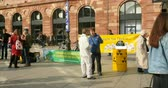au : STRASBOURG, FRANCE- CIRCA MAR 2016: Protesters with placards and megaphone and music protesting against the transportation through France of the nuclear waste in central of Strasbourg Place Kleber