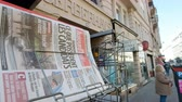 manchete : PARIS, FRANCE - MAR 23, 2017: Man buying AujordHui - Today French newspaper at press kiosk newsstand featuring headlines following the terrorist incident in London at the Westminster Bridge