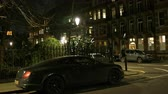 rolls royce : LONDON, UNITED KINGDOM - CIRCA 2017: Luxury Bentley Continental GT Convertible Cabriolet parked on the street  in London neighborhood street - night scene