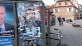 melenchon : STRASBOURG, FRANCE - APR 26, 2017: pan from street view to multiple vandalized elections posters of Emmanuel Macron and others on the first round of 2017 French presidential election