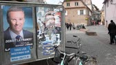 melenchon : STRASBOURG, FRANCE - APR 26, 2017: Street view of multiple vandalized elections posters of Emmanuel Macron and others on the first round of 2017 French presidential election Stock Footage