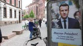 melenchon : STRASBOURG, FRANCE - APR 26, 2017: French street view with elections posters of Emmanuel Macron and others on the first round of 2017 French presidential election Stock Footage