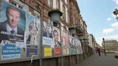melenchon : STRASBOURG, FRANCE - APR 23, 2017: French presidential posters for the upcoming presidential election in France, in front of the City Hall Hotel de Ville building in Strasbourg