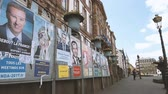 melenchon : STRASBOURG, FRANCE - APR 23, 2017: Wide view of French presidential posters for the  presidential election in France, in front of the City Hall Hotel de Ville building in Strasbourg