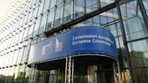 funcionários : BRUSSELS, BELGIUM - CIRCA 2016 Entrance of Charlemagne building with European Commission logo with the Berlaymont building facade of the European Commission in Brussels, Belgium reflected Stock Footage
