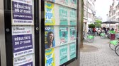 polling place : STRASBOURG, FRANCE - MAY 7, 2017 Election results in France Le Monde poster in press kiosk and city perspective during the second round of the French election between Emmanuel Macron and Marine Le Pen