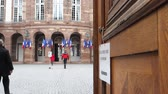 polling place : STRASBOURG, FRANCE - MAY 7, 2017: French city-hall with people heading to vote during the second round of  French presidential election to choose between Emmanuel Macron and Marine Le Pen slow motion