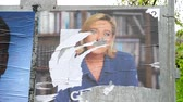 polling place : STRASBOURG, FRANCE - MAY 7, 2017: Le Pen damaged poster during the second round of the French presidential election to choose between Emmanuel Macron and Marine Le Pen