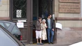 polling place : STRASBOURG, FRANCE - MAY 7, 2017: Grandchildrens and  grandmother exits polling station during the second round of the French presidential election to choose between Emmanuel Macron and Marine Le Pen
