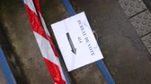 polling place : Pan over Bureau de vote sign polling station on floor near pooling place during the second round of the French presidential election to choose between Emmanuel Macron and Marine Le Pen