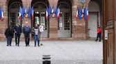 polling place : STRASBOURG, FRANCE - MAY 7, 2017: French city with family leaving polling place during the second round of the French presidential election to choose between Emmanuel Macron and Marine Le Pen