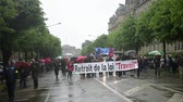 strike : STRASBOURG, FRANCE - MAY 12, 2016: Retire labor law placard as thousand of people demonstrate as part of nationwide day of protest against labor reforms by France Government