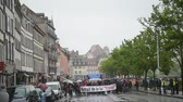 valls macrom : STRASBOURG, FRANCE - MAY 12, 2016: Closed central street as thousand of people demonstrate as part of nationwide day of protest against labor reforms by France Government