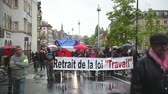 valls macrom : STRASBOURG, FRANCE - MAY 12, 2016: Retire labor law placard as thousand of people demonstrate as part of nationwide day of protest against labor reforms by France Government