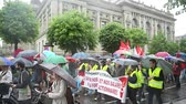 valls macrom : STRASBOURG, FRANCE - MAY 12, 2016: Raining at protest - CGT France - General Confederation of Labour demonstrate as part of nationwide day of protest against labor reforms by France Government Stock Footage