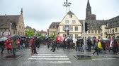 valls macrom : STRASBOURG, FRANCE - MAY 12, 2016: Closed central street thousand of people demonstrate as part of nationwide day of protest against labor reforms by France Government