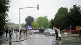 valls macrom : STRASBOURG, FRANCE - MAY 12, 2016: Raining over police car surveillance of thousands of people demonstrate as part of nationwide day of protest against labor reforms by France Government