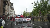french street : STRASBOURG, FRANCE - MAY 12, 2016: Police surveilling crowd as thousand of people demonstrate as part of nationwide day of protest against labor reforms by France Government
