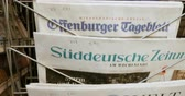 newspaper stack : PARIS, FRANCE - CIRCA 2017: German newspapers on stand of a press kiosk featuring headlines Stock Footage